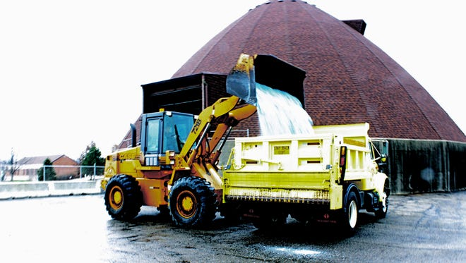 Colerain Township public service worker Joe Siebert loads his truck with salt. Road crews across the county were gearing up for snow and ice as they monitored weather forecasts back in October. Forecasters predicted 3-5 inches of snow for Sunday night and early Monday morning.