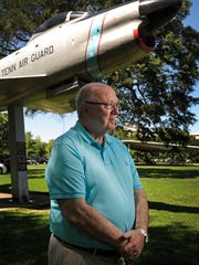 Jim Fyke stands in front of the F-86L Sabre Jet at
