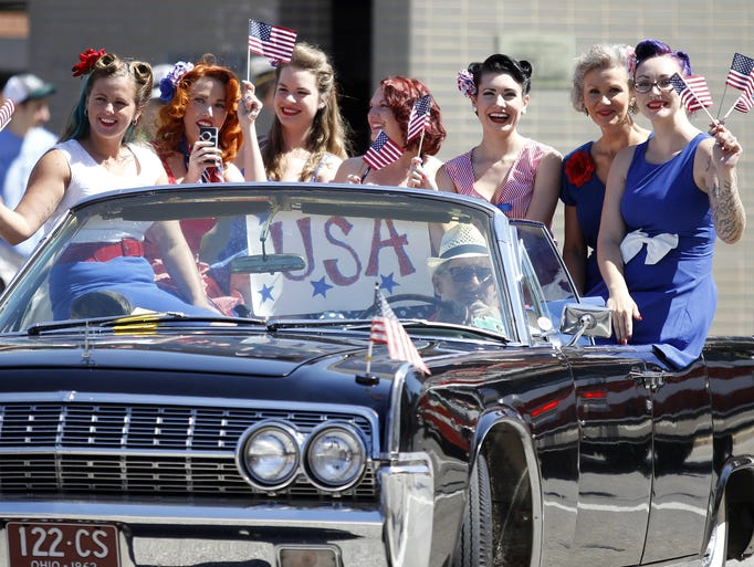 """Members of the Patriot Pin Up, Inc., Cincinnati chapter were among the participants of the """"Welcome Home: A Salute to Service"""" parade Saturday. Patriot Pin Up, Inc, is a group of women who send care packages to military over seas, raise money for veterans with PTSD and visit VA hospitals."""