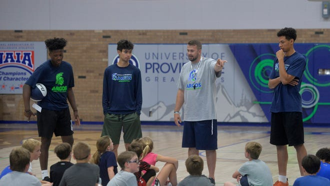 J.C. Isakson, an Augusta native, is the new assistant men's basketball coach at the University of Providence. He is helping his boss, UP men's head coach Steve Keller, with a basketball camp this week at McLaughlin Center.