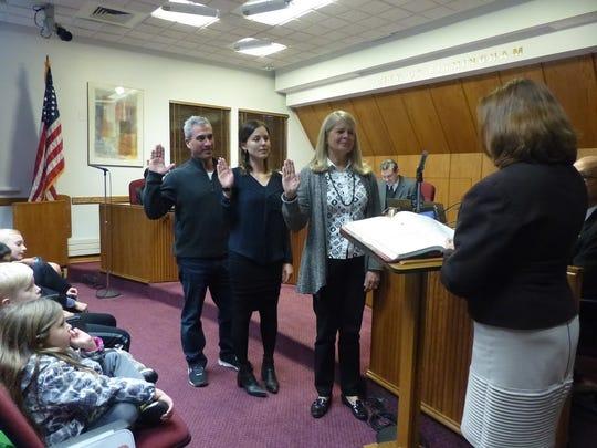 Baldwin Public Library board members Frank Pisano, Ashley Aidenbaum and Melissa Mark were sworn in Monday.