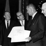 U.S. President Lyndon B. Johnson holds the signed document of the Voting Rights Act of 1965 as he chats Aug. 6, 1965 with Sen. Everett Dirksen, R-Illinois, in the President's Room in Washington, D.C. Signatures that appear on the document are Lyndon Johnson, left bottom; House Speaker John McCormack, upper, standing at right; and Vice President Hubert Humphrey, lower, standing second from left. Standing at far left is Sen. Mike Mansfield.