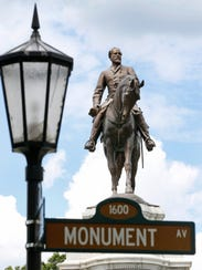 The statue of Robert E. Lee stands in a traffic circle