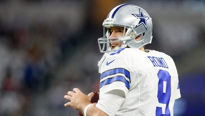Dallas Cowboys quarterback Tony Romo (9) warms up before the game against the Green Bay Packers in the NFC Divisional playoff game at AT&T Stadium.