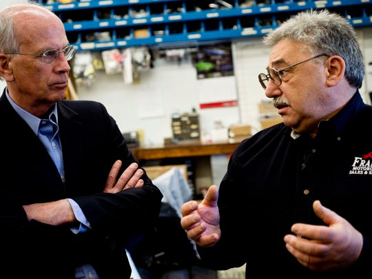 From left, Rep. Peter Welch, D-VT, listens to Lester Pelkey, owner of Frank's Motorcycles Sales & Services in Essex Junction, talk about the damage to fuel and engine components from corn ethanol, a gasoline additive.