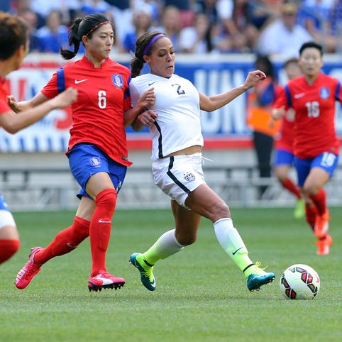 USA forward Sydney Leroux (2) and Korea defender Shim Seoyeon (6) fight for the ball during the first half at Red Bull Arena.