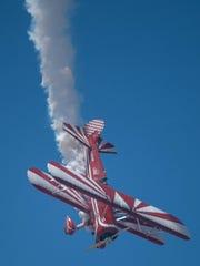 Susan Dacy makes smoke trails in her Super Stearman