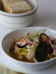 Seafood cocktail of mussels, clams and shrimp in an