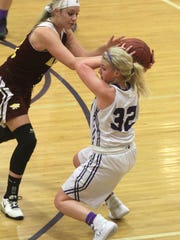 Indianola senior Maddie Glascock snatches a loose ball in front of Ankeny junior Codee Myers. Class 5-A fifth-ranked Indianola beat Ankeny 52-47 in Indianola on Dec. 15.