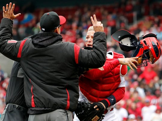 St. Louis Cardinals catcher Yadier Molina, right, throws off his mask as he argues with Arizona Diamondbacks manager Torey Lovullo during an altercation in the second inning of a baseball game Sunday, April 8, 2018, in St. Louis. (AP Photo/Jeff Roberson)