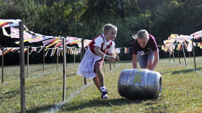 Aurora Nargi and Layla Lantz compete in a barrel race during Oktoberfest at the Frontier Culture Museum in Staunton.