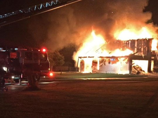 Tom and Pam Price's home burns early Saturday morning.