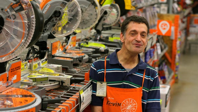 Home Depot employee Kevin Woolley has been on the job for 20 years with cerebral palsy.