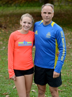 Seton Catholic cross country team members Jenna Barker, left, with father and coach Todd Barker, right, before practice at Hayes Arboretum Tuesday, Oct. 21, 2014.