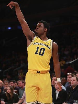 Michigan guard Derrick Walton Jr. reacts after hitting a three Friday in New York.