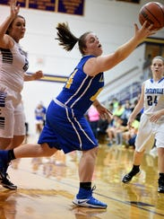 Lincoln's Kerrigan Neff reaches for the ball against