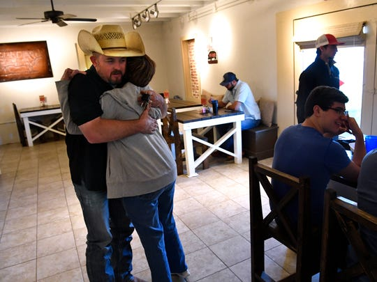 Joe Campbell is thanked by a friend Saturday at 5-C Smokehouse in Clyde. The restaurant has been open since July.