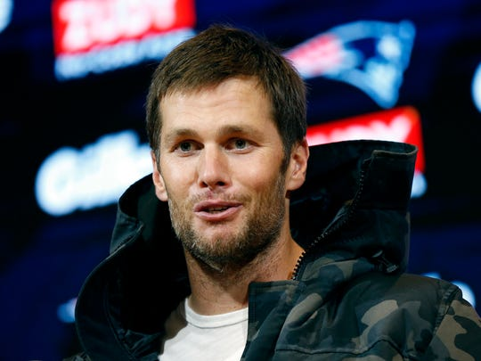 New England Patriots quarterback Tom Brady and Jeff have shared an awkward hug.