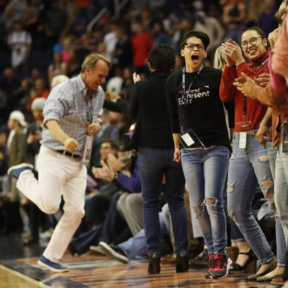 Phoenix Suns fans cheer after a late lead against the