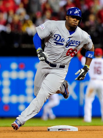 Dodgers right fielder Yasiel Puig rounds second base