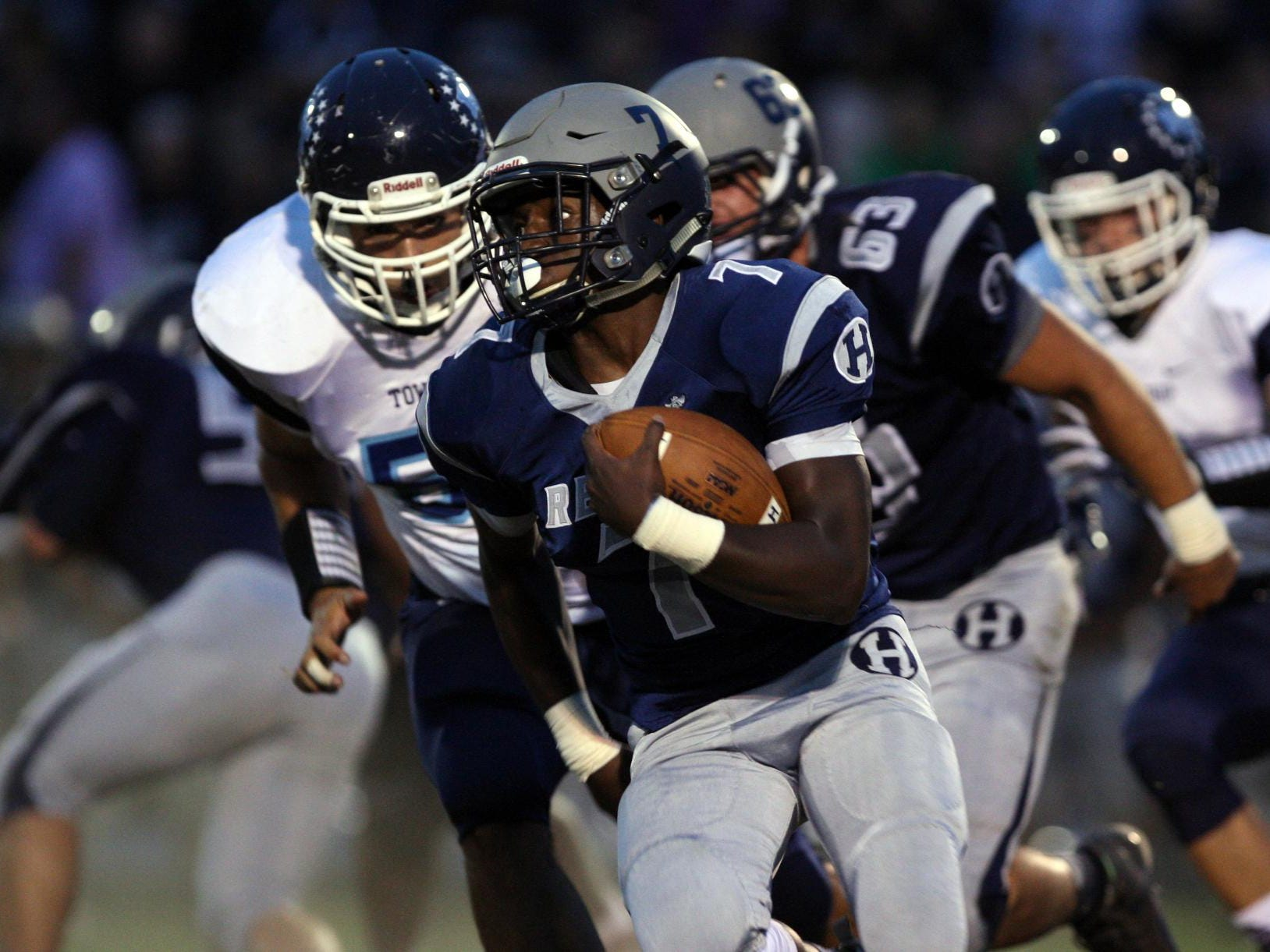 Mekai Gandy, #7 Howell, carries the ball against Freehold Township in a football game Friday, September 25, 2015, at Howell High School.