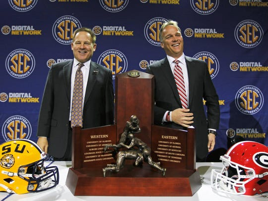 Former Georgia coach Mark Richt (right) stands alongside the SEC trophy with LSU coach Les Miles before the 2011 SEC Championship game.