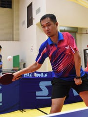 Paralympian table tennis player Norby Ocampo, 37, keeps his eyes on the ball during an exhibition game at the Guam Sports Complex gym in Harmon on Jan. 26, 2017.