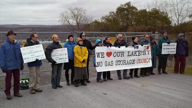 Protesters stand outside the Crestwood Midstream facility in the Town of Reading on Oct. 23.