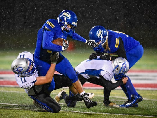 Bodin Semrau of Foley tries to tackle Cathedral's Kendrick