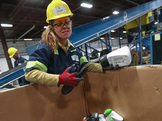 Transitional employee Brooke Cash works at Recycle Force in Indianapolis, Wednesday, Feb. 16, 2017. Cash has worked at Recycle Force for four months. She finished her work-release program in late January this year and is now on house arrest, making the hour drive to work five days a week. In the future, she hopes to better her relationship with her 13-year-old son and find a career helping women and children who face situations similar to what has been through.
