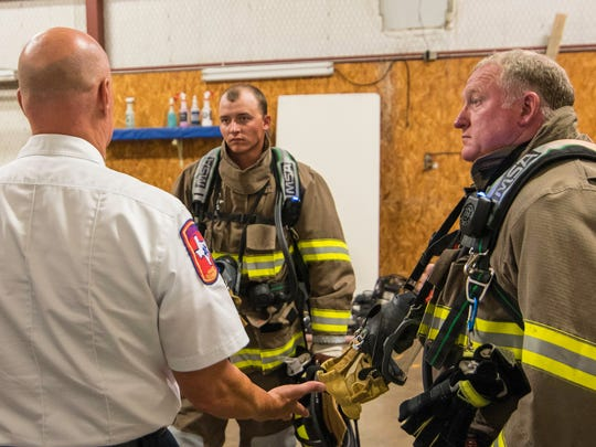 "San Angelo firefighters Taylor Jordan and Don Ferguson receive a final briefing before entering a ""burning structure"" to retreive a firefighter that has gotten lost after ""losing the hose"" during RIT (Rapid Intervention Team) training July 26, 2017"