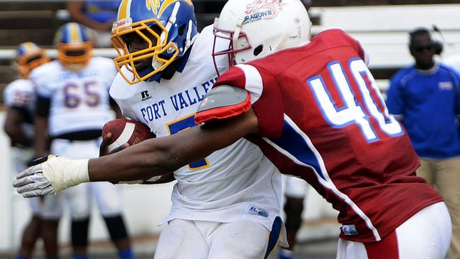 Lane College's Whitney Richardson tackles a Fort Valley player in the backfield during Saturday's game. Lane defeated Fort Valley State, 10-7.