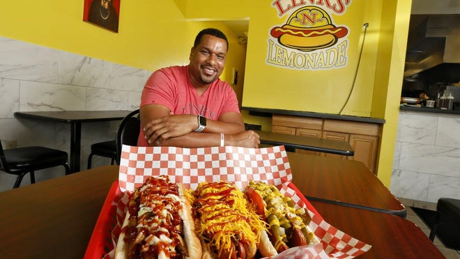 Damon Owens in his restaurant Links-N-Lemonade at Graceland Shopping Center. The hotdogs featured are The Clevelander, Famous Coney Dog, and Windy City. August 15, 2019.