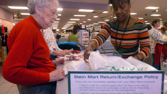A customer makes a purchase at Augusta's Stein Mart store in this 2004 file image. The store in the Washington Square shopping center will close this year as part of the Florida-based retailer's Chapter 11 filing.