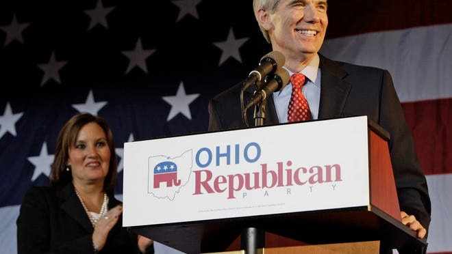 Ohio Lt. Gov. Mary Taylor, left, applauds as U.S. Sen. Ohio Rob Portman takes the stage at a GOP celebration November 2012. The Terrace Park Republican came out in support of gay marriage in March 2013.