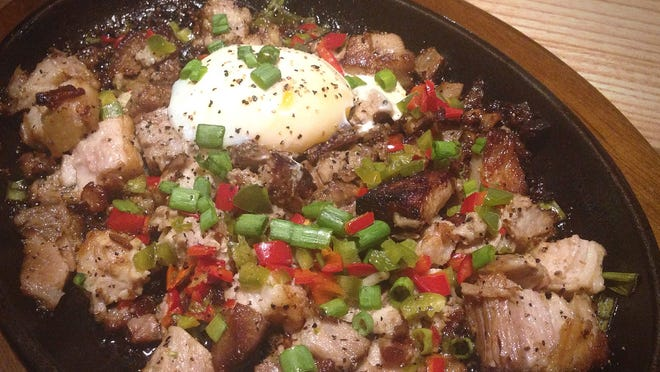 "Sisig ($12, pronounced ""sea-sig""), diced pork belly, egg and rice, at 30hop in Coralville."