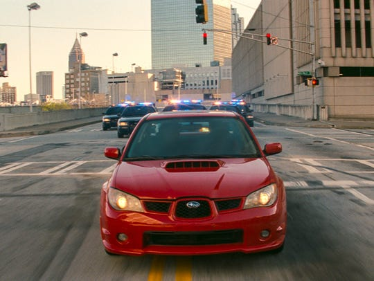 Baby speeds through Atlanta in a Subaru WRX with cops