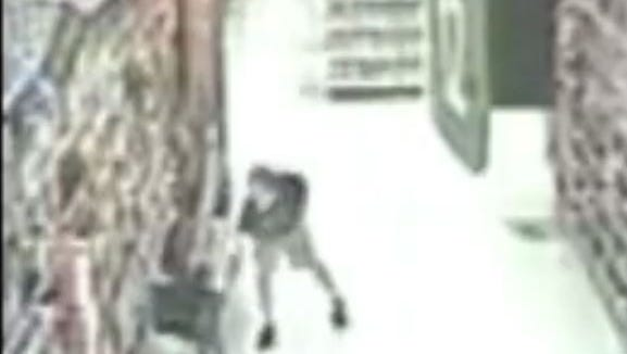 Police say this image shows Joshua Nicholas of Williamstown taking an upskirt video at Walmart in Turnersville.