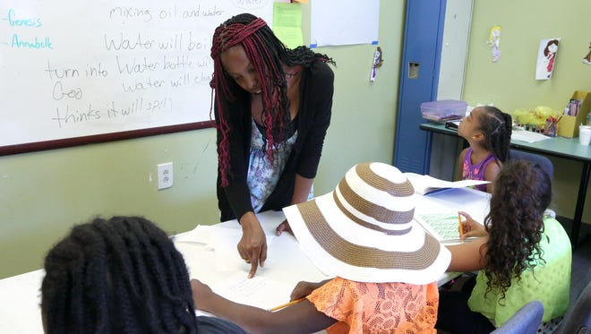 Gardenia Leguillow teaches a class during summer camp at the Martin Luther King Multi-Purpose Center in Spring Valley July 20, 2016.