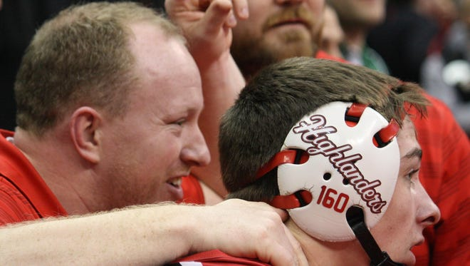 Oak Hills senior Dylan Roth celebrates with his coach, Joe Campolongo, after Roth won his quarterfinal match and earned a spot in the Division I state semifinals.