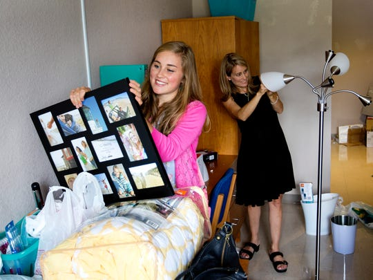 Ave Maria University incoming freshman, Caitlin Bostrom moves into her dorm room with the help of her mother, Collete on Thursday 8/28/2014.