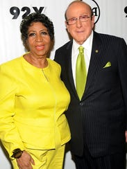 Aretha Franklin, left, and Clive Davis attend an event