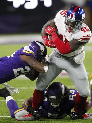 Giants tight end Will Tye is tackled by Minnesota Vikings' Captain Munnerlyn, left, and Eric Kendricks in the first half of Monday night's NFL game.