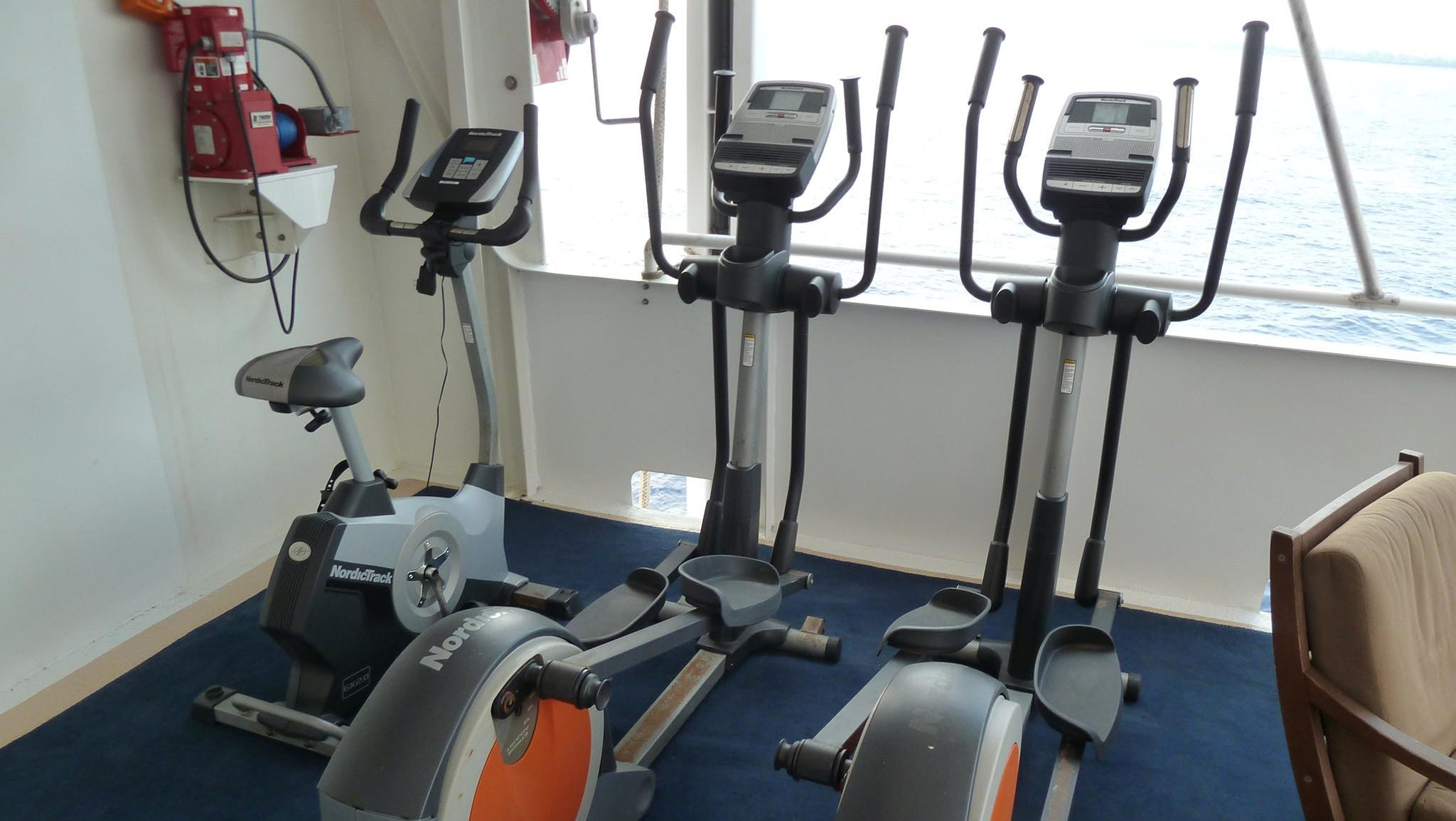 The Safari Explorer's uppermost level, Bridge Deck, has sheltered and open space that includes an exercise area with two ellipticals and a stationary bike. Every morning, early risers can partake of a pre-breakfast yoga session on deck.