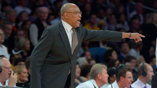 Los Angeles Lakers head coach Bernie Bickerstaff gestures during the second half of their NBA basketball game against the Houston Rockets, Sunday, Nov. 18, 2012, in Los Angeles.