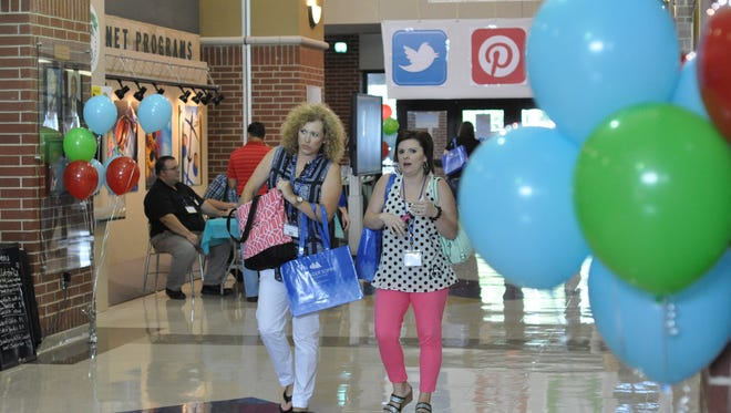 Area educators arrive Monday morning at Peabody Magnet High School for the Rapides Parish School District's 2016 Summer Institute.