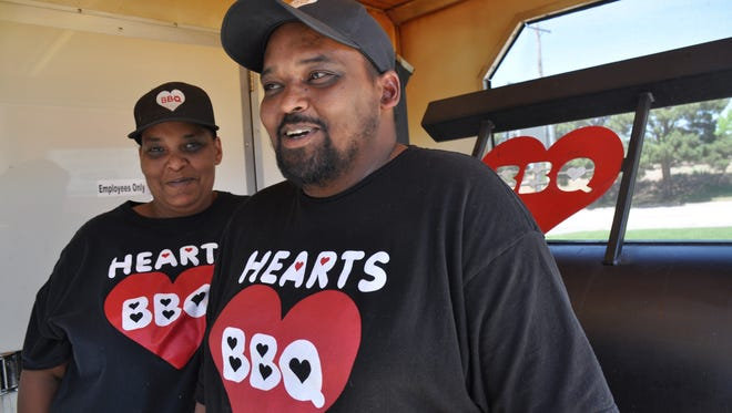 Sharleene Jacques and her brother Ian Dixon stand in front of their grill Stella on their Hearts BBQ food trailer on April 11. They started their business in May 2017.