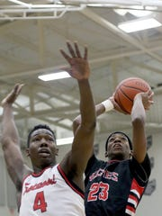 Hughes' D.J. Brewton drives to the basket during the