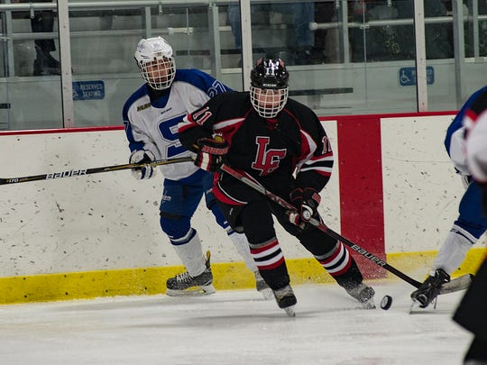 Livonia Churchill's John Doyle (No. 11), shown from a recent game against Salem, had a big game against South Lyon along with linemates Jordan Venegoni and Tyler Haydu.