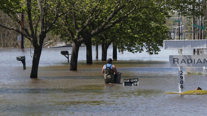 In this Wednesday, May 20, 2020, file photo, waters overflow the Tittabawassee River, Wednesday, May 20, 2020, in Midland. Michigan Gov. Gretchen Whitmer is calling for an investigation into what caused two mid-Michigan dams to fail, flooding a number of communities and forcing the evacuations of 11,000 people from their homes.